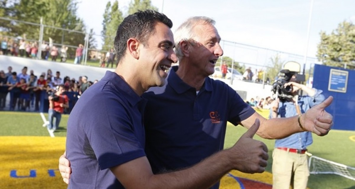 Xavi Hernández i Johan Cruyff en una imatge d'arxiu