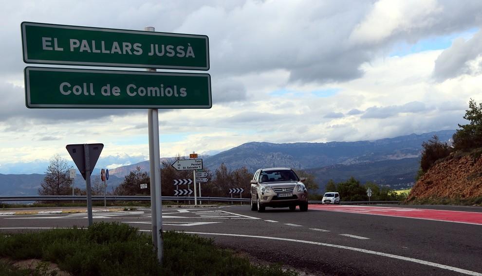 Imatge del cap de Comiols on es veu el rètol d'entrada al Pallars Jussà