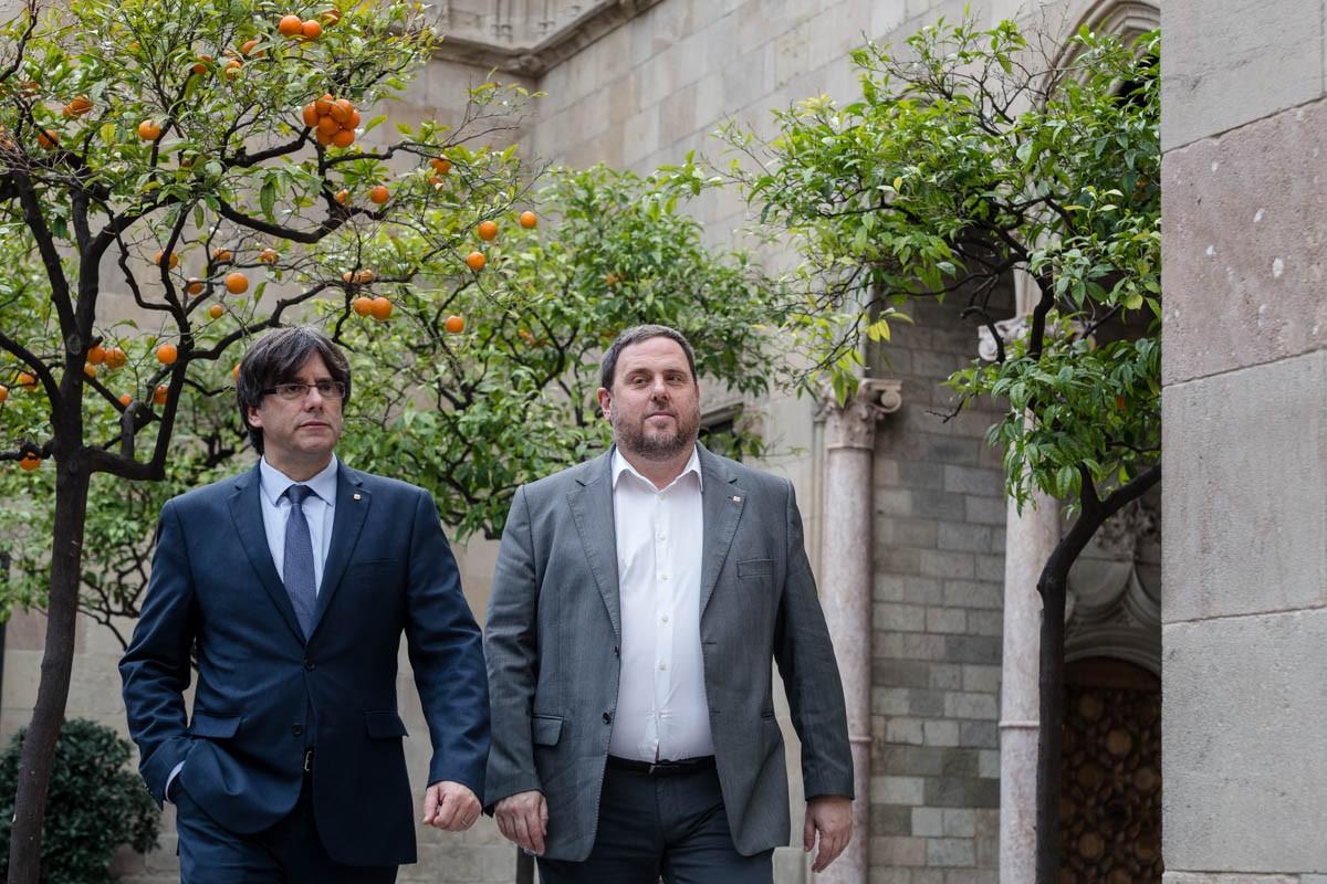 Carles Puigdemont i Oriol Junqueras, en una imatge d'arxiu a Palau