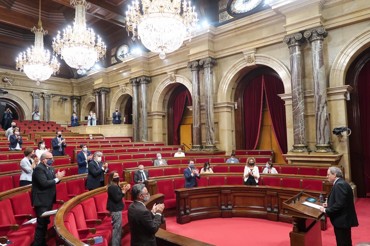 Quim Torra, aplaudit al Parlament, després del discurs a l'hemicicle