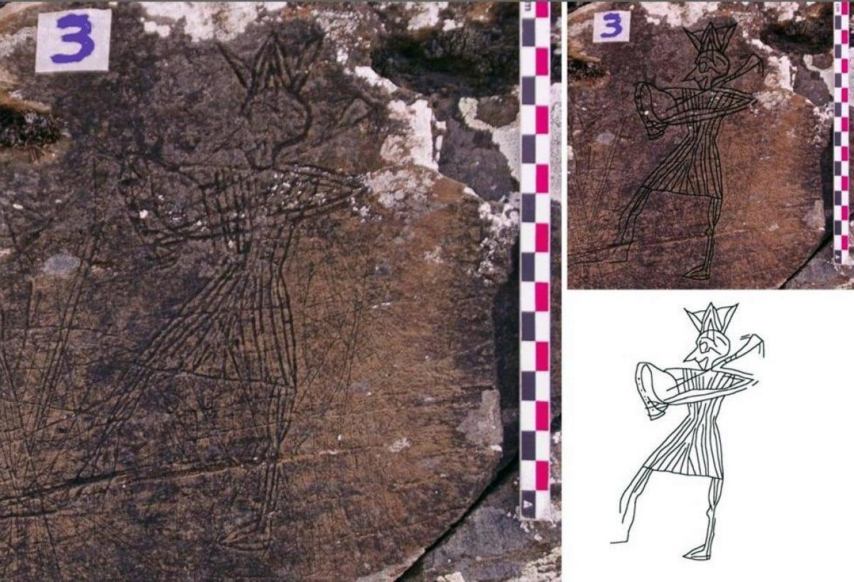 Imatge de detall i calc d'una figura d'un músic amb cornamusa